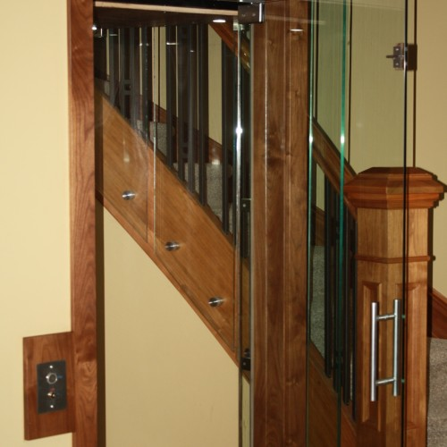 glass elevator with door open