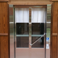 Bi-fold stainless steel elevator door