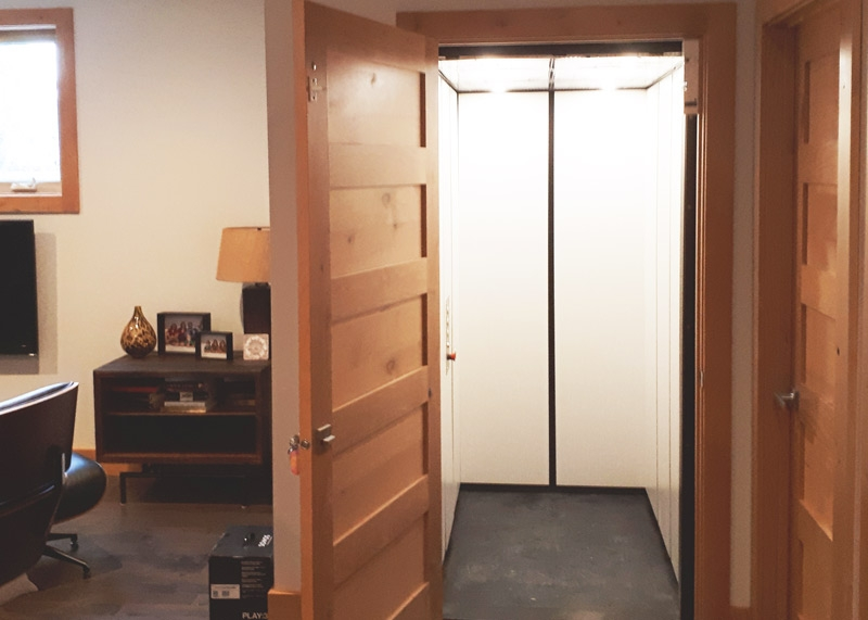 Residential Elevators, hidden with wooden door